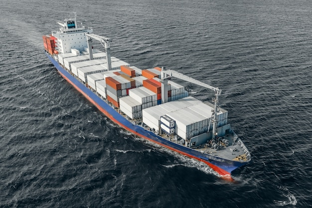 Aerial view of container vessel floating in the open sea