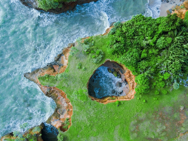 Aerial view of coral beach on the beach. the view of the sea of bengkulu, indonesia. love beach in indonesia