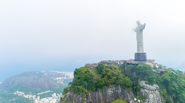 Aerial view of cristo redentor, christ the redeemer statue over rio de janeiro city, brazil