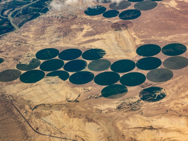Aerial view of crop irrigation circles, green river, utah