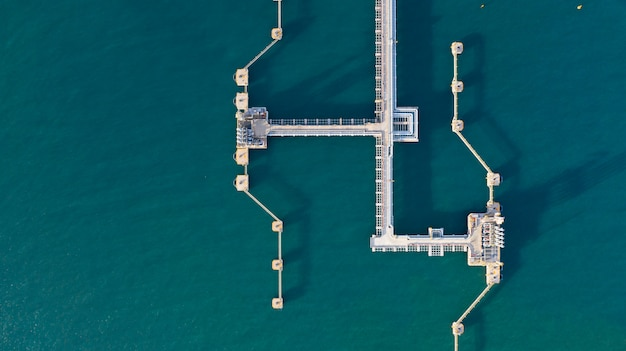 Aerial view crude oil and gas terminal, loading arm oil and gas refinery at commercial port.