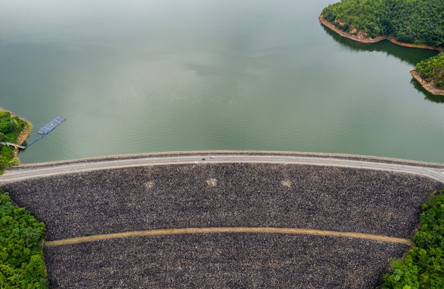 Aerial view of dam in tropical rainforest with hydro power plant in national park at kanchanaburi, thailand