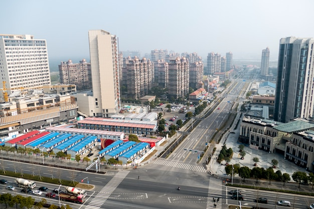 Aerial view of the district in shanghai with roads and high-rise buildings