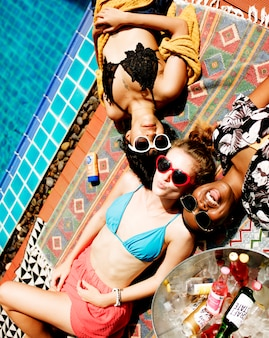 Aerial view of diverse women lying under the sun