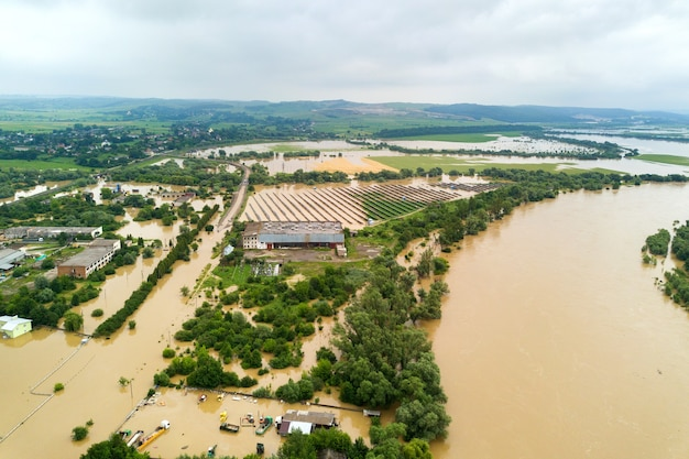 Aerial view of dnister river with dirty water and  flooded houses in halych town, western ukraine.