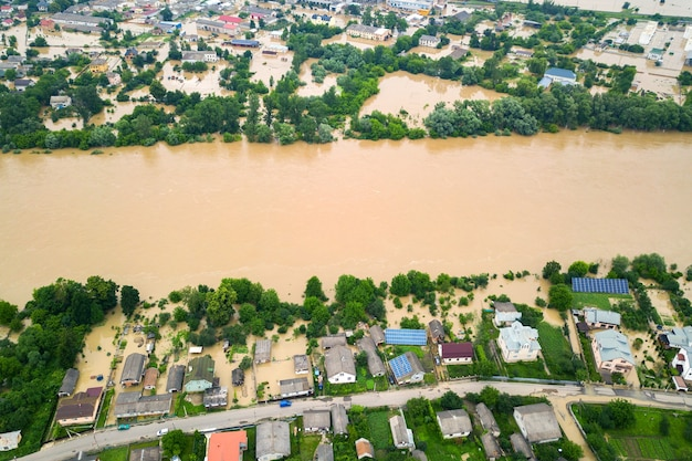 Aerial view of dnister river with dirty water and  flooded houses in halych town, western ukraine