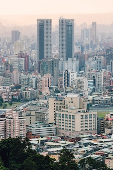 Aerial view over downtown taipei with layers of mountain