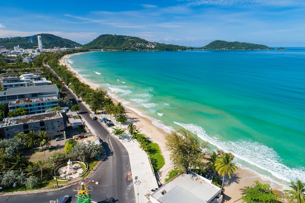 Aerial view drone camera amazing sea nature view over patong city phuket thailand in the morning beautiful patong beach in summer season.