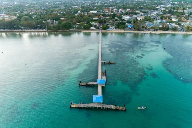 Aerial view drone camera shot of long bridge at rawai beach phuket thailand.