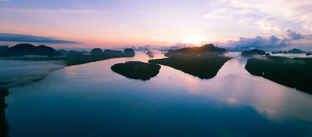 Aerial view drone panorama of beautiful ocean against sky in the morning fog mist sunrise drone is f