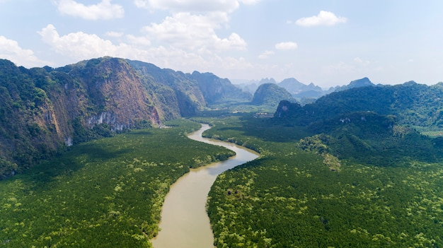 Aerial view drone shot of beautiful natural scenery river in mangrove forest and high mountains in phang nga province thailand