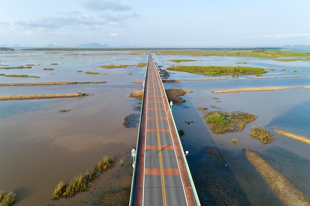 Aerial view drone shot of bridge(ekachai bridge)colorful road bridge cross the lake