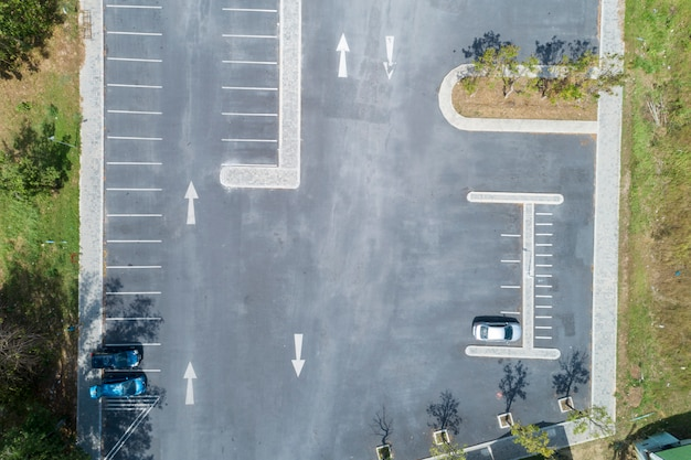 Aerial view drone shot of parking lot outdoors vehicles in the park
