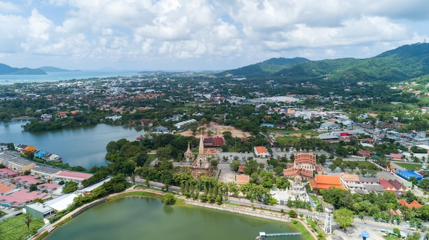 Aerial view drone shot of wat chalong temple or wat chaithararam in phuket thailand.