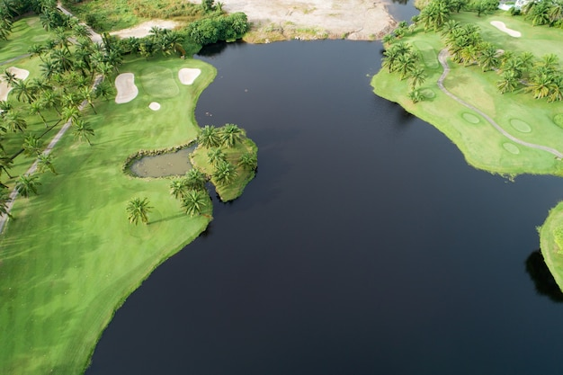 Aerial view drone top down shot of beautiful green golf field high angle view in summer sunny day amazing view.