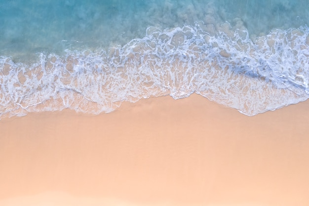 Aerial view of drone top view of beach sea sand and seawater in nature sunny