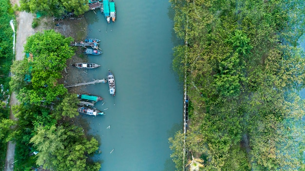 Aerial view drone top view of longtail fishing boats in the river