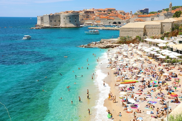 Aerial view of dubrovnik old town and banje beach, adriatic sea