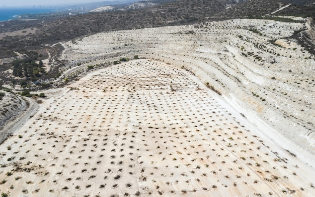 Aerial view of ecosystem restoration works at abandoned limestone quarry near limassol, cyprus