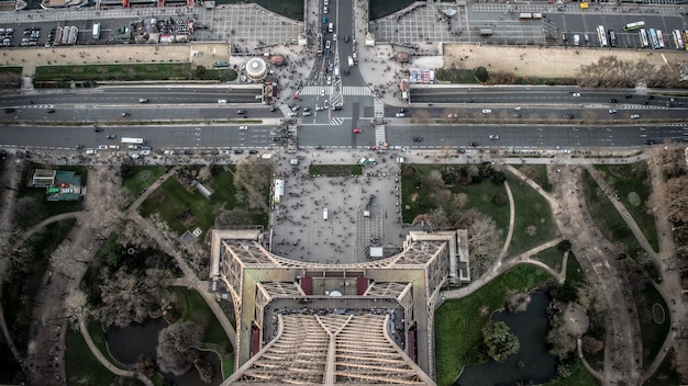 Aerial view of eiffel tower during daytime with a lot of cars