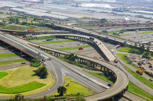 Aerial view of empty highway interchange with disappearing traffic on a bridge and streets roads and lanes crossroads cars newark nj usa