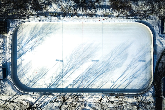 Aerial view of empty hockey skate rink on a winter sunny day