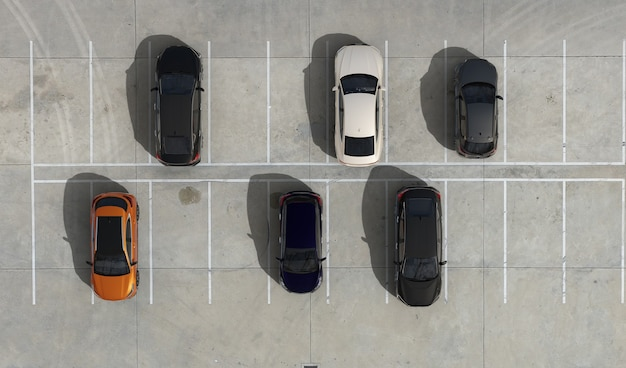 Aerial view of empty parking lots and cars parked