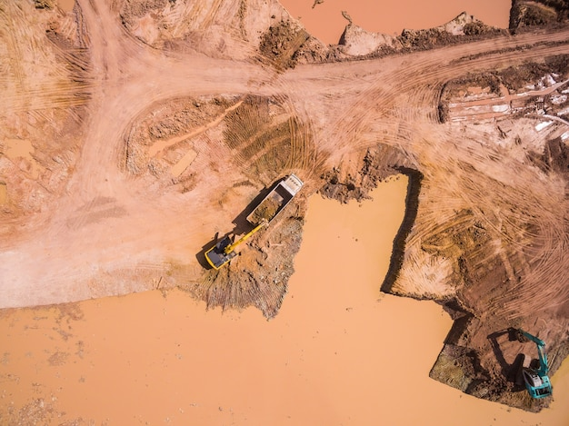 Aerial view of excavator and truck working