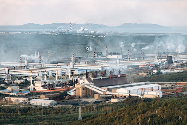 Aerial view of the factory. environmental pollution. the pipes emit smoke into the atmosphere.