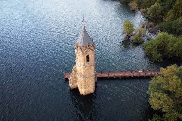 Aerial view of the fish cathedral. sunken church ruins located in the ebro reservoir in cantabria, in the north of spain