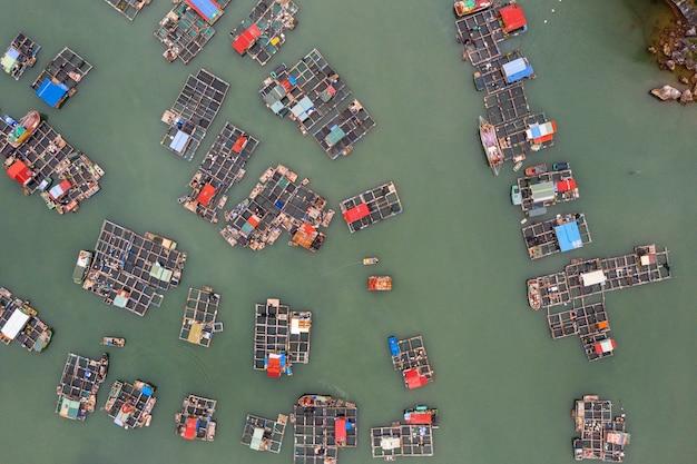 Aerial view of floating fishing village in lan ha bay, vietnam. unesco world heritage site. near ha long bay