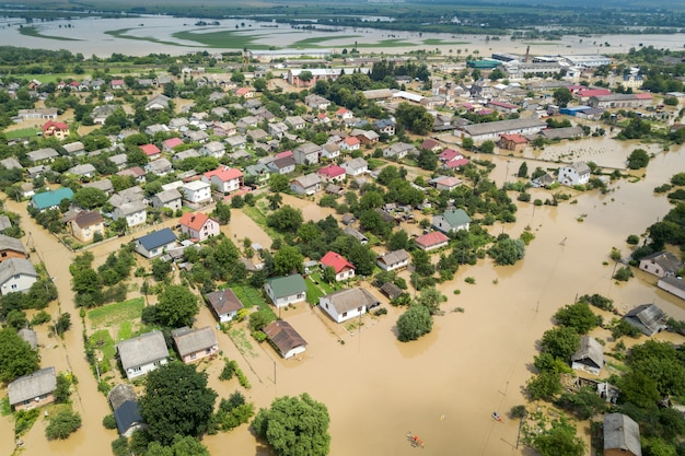 Aerial view of flooded houses with dirty water of dnister river in halych town, western ukraine.
