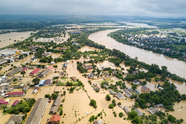 Aerial view of flooded houses with dirty water