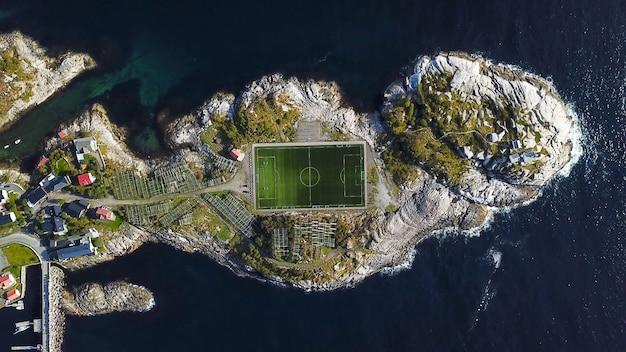 Aerial view of football field or soccer field in the henningsvaer, lofoten islands, norway.
