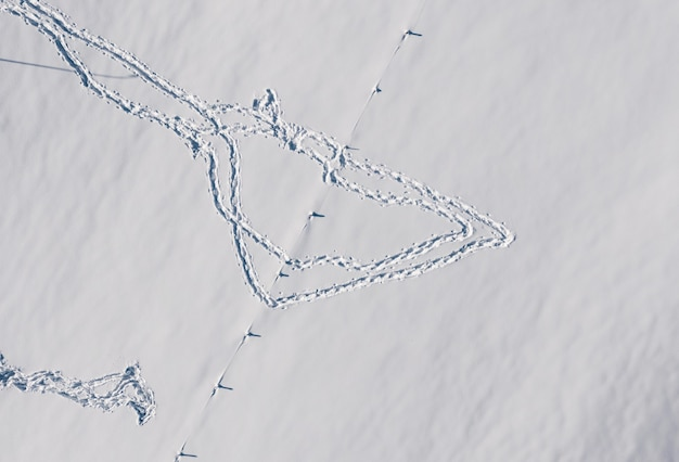 Aerial view of the footprints on the snow in winter