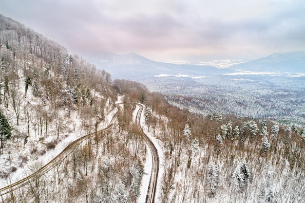 Aerial view of a forest in the vosges mountains in winter. alsace, france