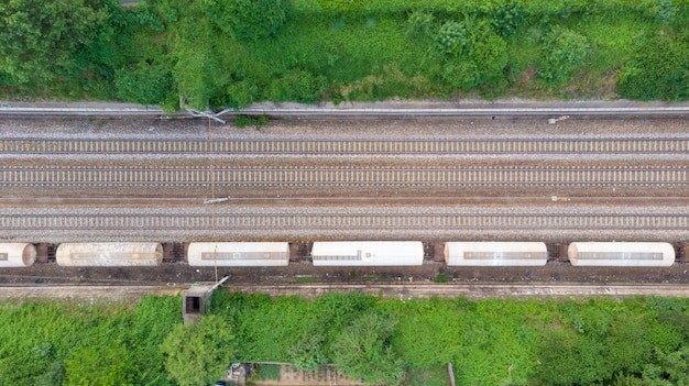 Aerial view freight trains in railway station. cargo trains wagons on railroad, top down. heavy industry ual, rail track in industrial district