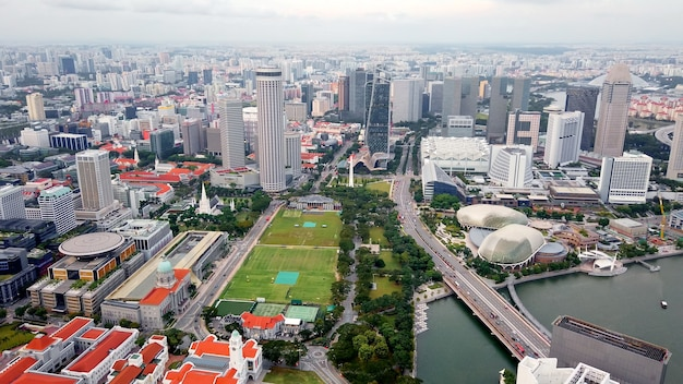 Aerial view from drone of business center, downtown, public park, skyscraper city singapore.