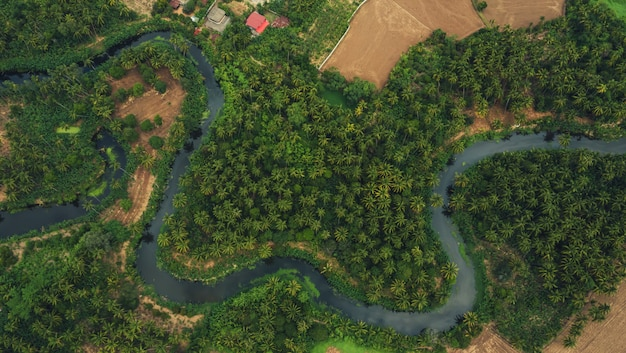 Aerial view from drone of devious river and agriculture area