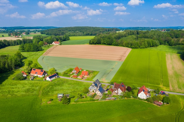Aerial view from the drone of landscape of the german countryside agricultural fields villages