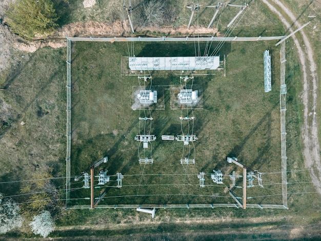 Aerial view from drone of power plant with transformers