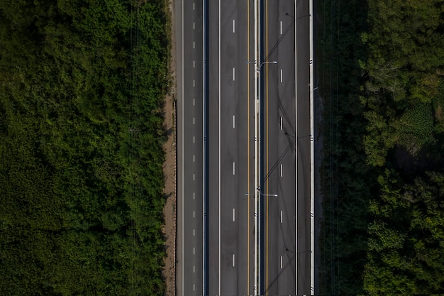 Aerial view from drone of road among forest in thailand