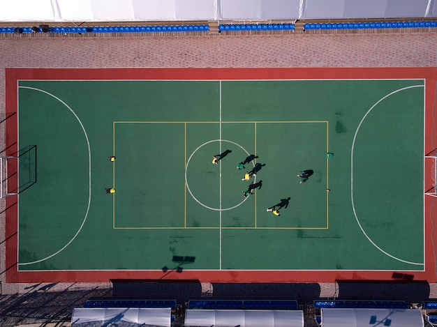 Aerial view from drone to soccer on mini field