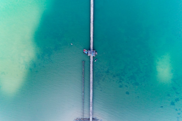 Aerial view from drone top view of long bridge in the sea