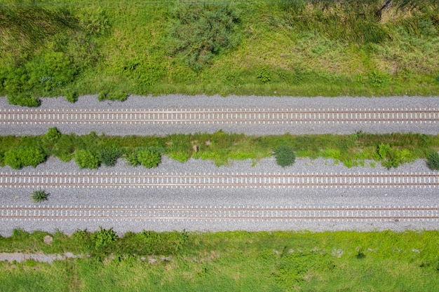 Aerial view from flying drone of railroad tracks, train