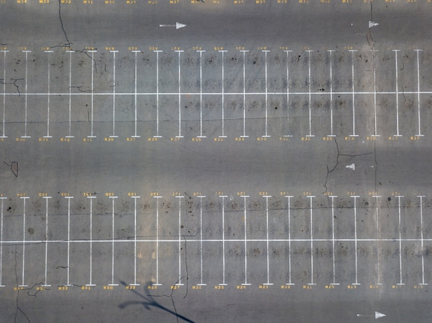 Aerial view from flying drones to parking markings with numbered places. parking background. top view