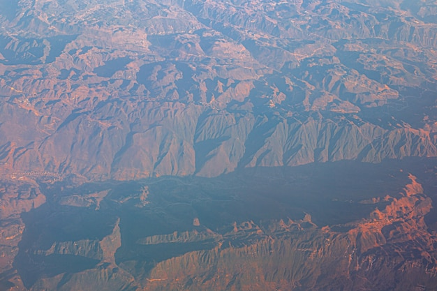 Aerial view from the plane to the tien shan mountains