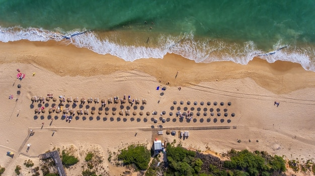 Aerial. view from the sky to the portuguese beach in the algarve, vale de lobo