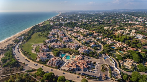 Aerial. view from the sky at the tourist town dunas douradas, vale de lobo.