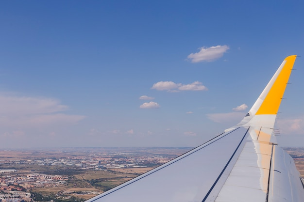 Aerial view from a window plane during flight. brown landscape above in spain. travel concept